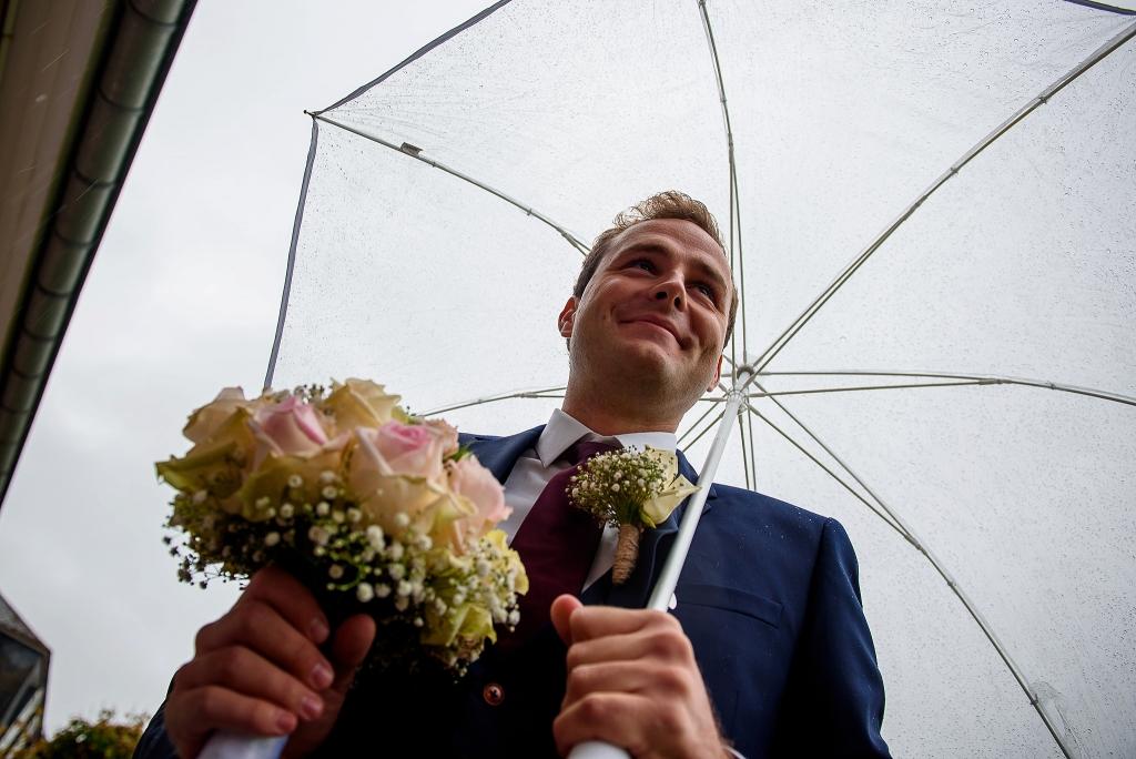 Huwelijksfotograaf bruidegom